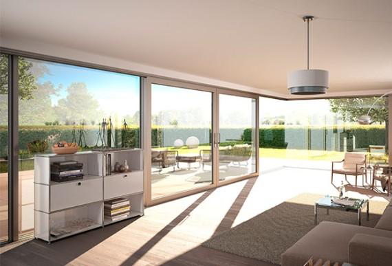 Aufsatzrollladen-Terrassenschiebetuer von Innen mit Blick in den Garten