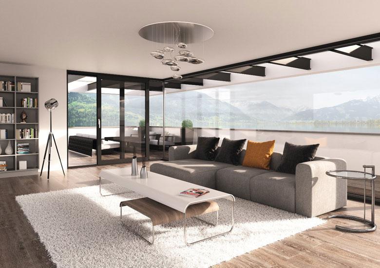 Die Terrassentür Kombiniert Mit Großen Glasfronten Lässt Den Wohnraum  Heller Und Größer Wirken Und öffnet Die Sicht In Die Natur.